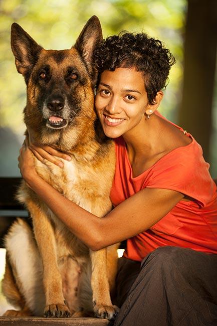 Lady dog sitter hugging dog